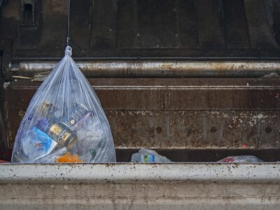 Where should you store full garbage bags?